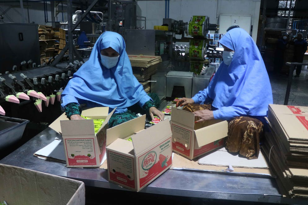 epa09206791 Afghan women work at Herat Ice Cream factory in Herat, Afghanistan, 17 May 2021. The factory, employs 200 workers, 50 of them women and produces 30 tons of ice cream and five Tons of dairy products on daily basis.  EPA/JALIL REZAYEE