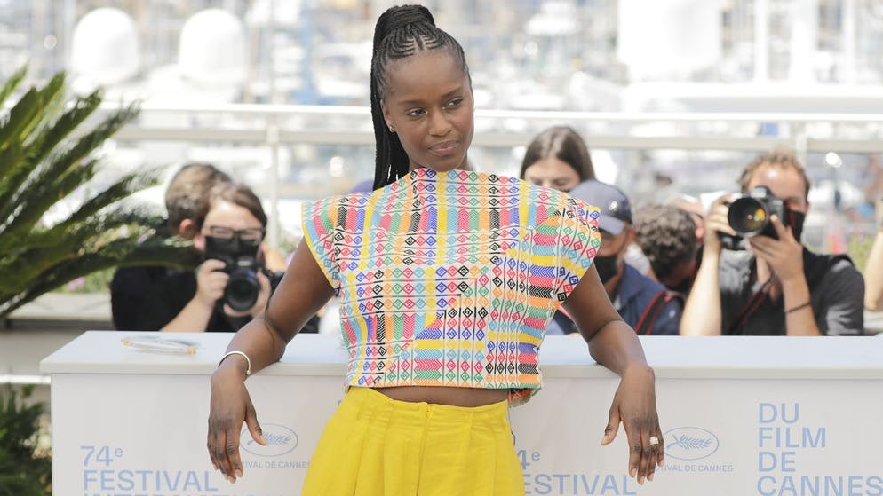 Fatou N'Diaye poses for photographers at the photo call for the film 'OSS 117: From Africa with Love' at the 74th international film festival, Cannes, southern France, Saturday, July 17, 2021. (Photo by Vianney Le Caer/Invision/AP)