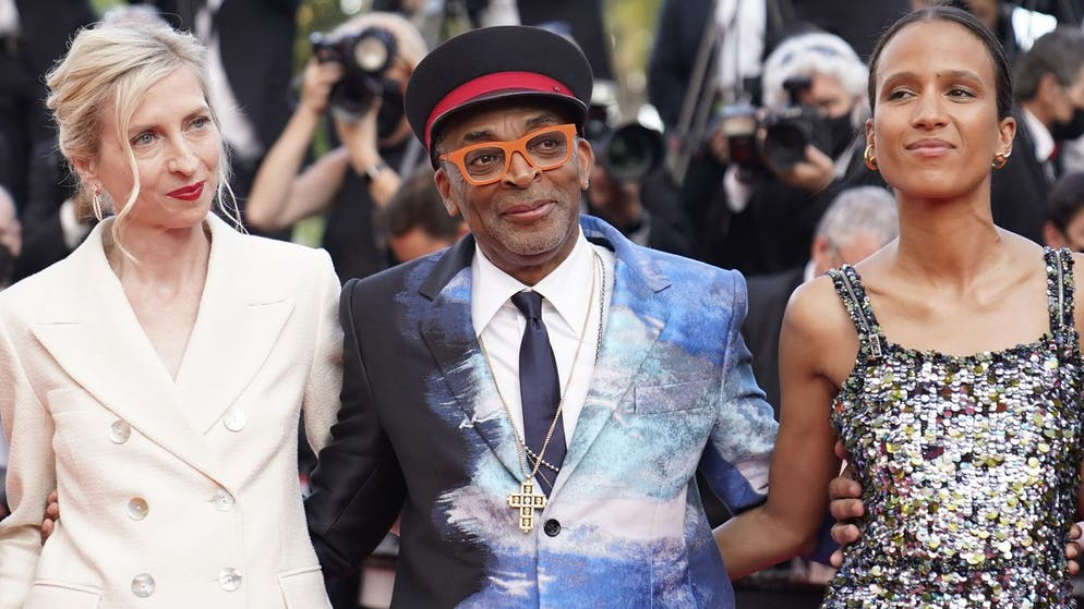 Jury president Spike Lee, center, poses with jury members Jessica Hausner, left, and Mati Diop upon arrival at the awards ceremony and premiere of the closing film 'OSS 117: From Africa with Love' at the 74th international film festival, Cannes, southern France, Saturday, July 17, 2021. (AP Photo/Brynn Anderson)
