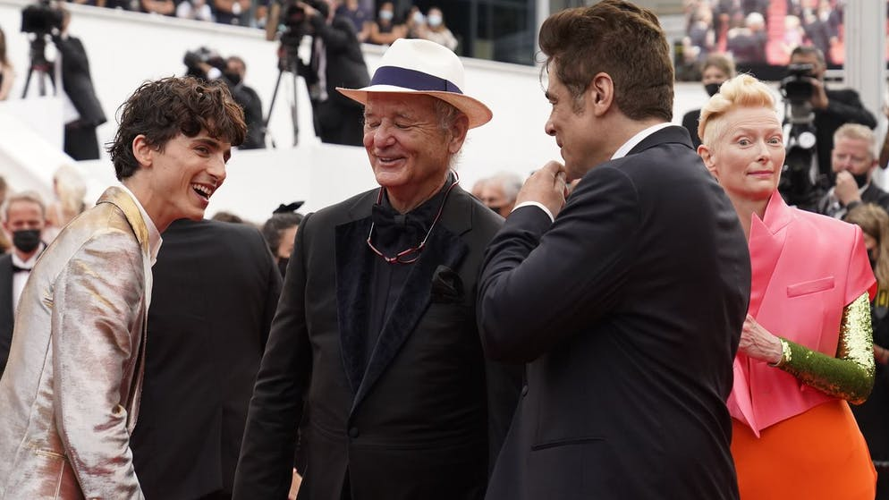 Timothee Chalamet, from left, Bill Murray, and Benicio Del Toro pose for photographers upon arrival at the premiere of the film 'The French Dispatch' at the 74th international film festival, Cannes, southern France, Monday, July 12, 2021. (AP Photo/Brynn Anderson)