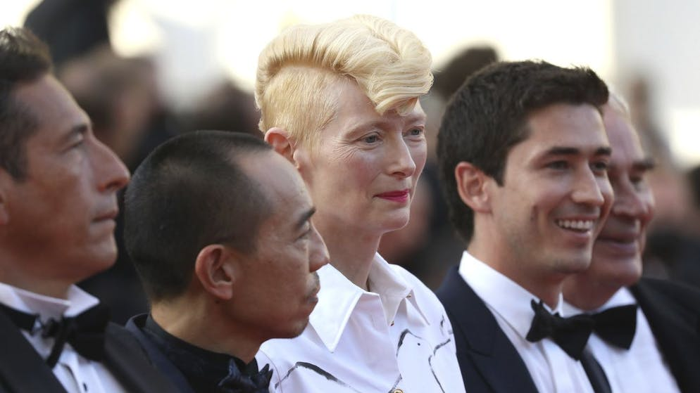 Tilda Swinton, center, poses for photographers upon arrival at the awards ceremony and premiere of the closing film 'OSS 117: From Africa with Love' at the 74th international film festival, Cannes, southern France, Saturday, July 17, 2021. (Photo by Vianney Le Caer/Invision/AP)
