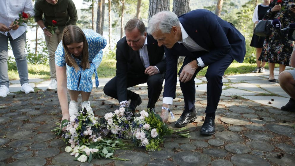 Leader of AUF youth political league in Norway, Astrid Hoem, Prime Minister of Sweden Stefan Lofven and leader of the Norwegian Labor Party Jonas Gahr Store, lay flower tributes at the memorial on Utoya island Wednesday July 21, 2021, the day before the 10th anniversary of the terrorist attack. The memorial to the attack victims, remains a construction site beset by changing plans, delays and court interventions, on the 10th anniversary of the July 22 attack that left 77 people dead on Utoya in Norway. (Beate Oma Dahle / NTB via AP)
