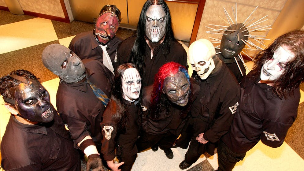 Music group SlipKnot pose before their show at Continental Airlines Arena in East Rutherford, N.J., March 6, 2005. (AP Photo/Jim Cooper)