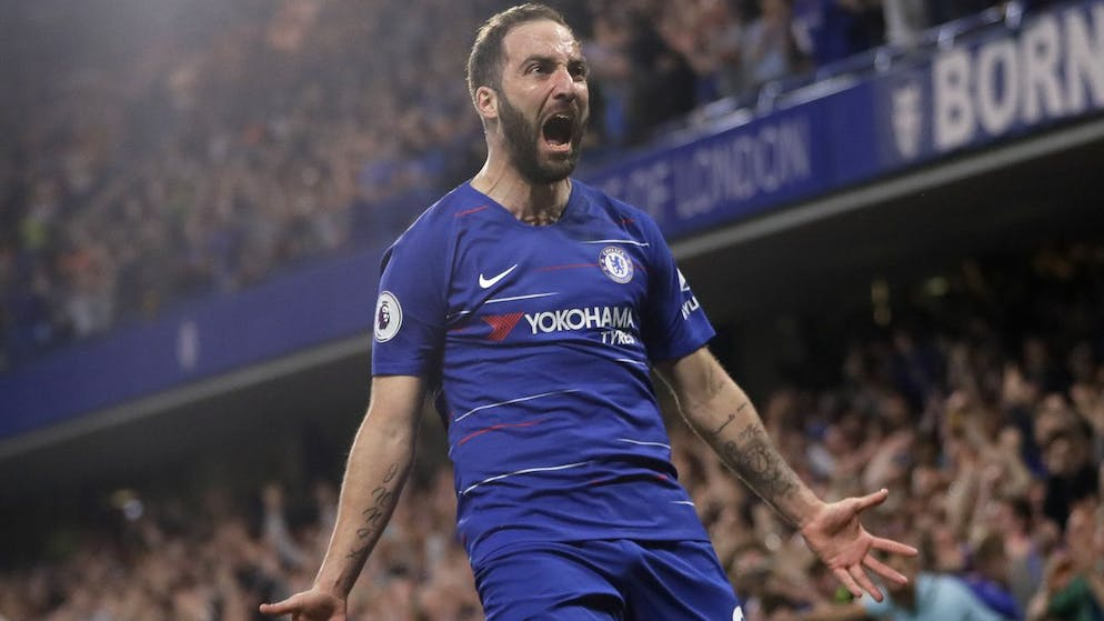 Chelsea's Gonzalo Higuain celebrates scoring his side's second goal during the English Premier League soccer match between Chelsea and Burnley at Stamford Bridge stadium in London, Monday, April 22, 2019. (AP Photo/Kirsty Wigglesworth)