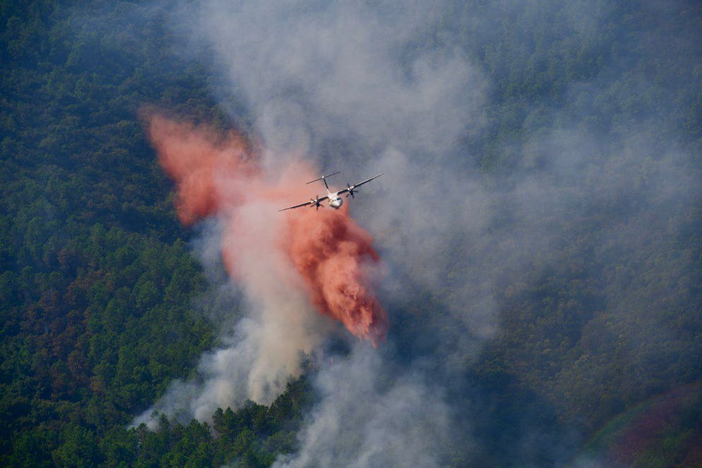 epa09419001 A handout photo made available by the French Interior Ministry shows a firefighting plane water-bombing a fire in Var department, southern France, 18 August 2021. Firefighters are battling wildfires and thousands of residents are evacuated in the area near St. Tropez.  EPA/J.GROISARD/HANDOUT  HANDOUT EDITORIAL USE ONLY/NO SALES HANDOUT EDITORIAL USE ONLY/NO SALES