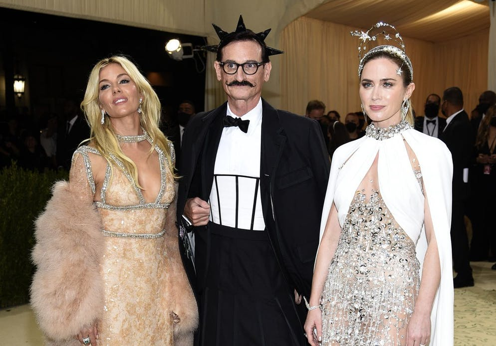 Sienna Miller, from left, Hamish Bowles and Emily Blunt attend The Metropolitan Museum of Art's Costume Institute benefit gala celebrating the opening of the