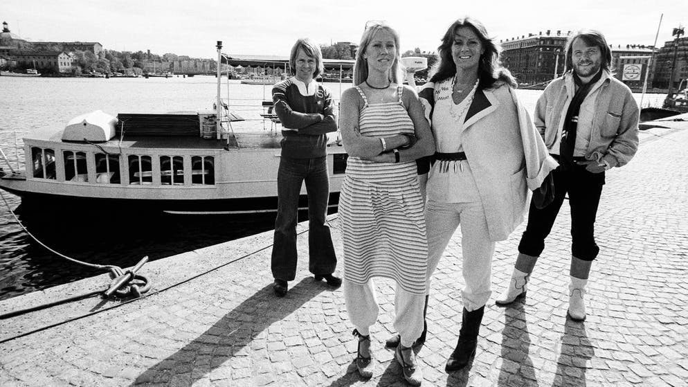 Portrait of Swedish Pop group ABBA as they pose, dockside, in Gamla Stan (Old Town), Stockholm, Sweden, July 1977. Pictured are, from left, Bjorn Ulvaeus, Agnetha Faltskog, Anni-Frid Lyngstad, and Benny Andersson. At the time, Ulvaeus and Faltskog were married while Lyngstad and Andersson were engaged, they married the following year. (Photo by Leif Skoogfors/Getty Images)
