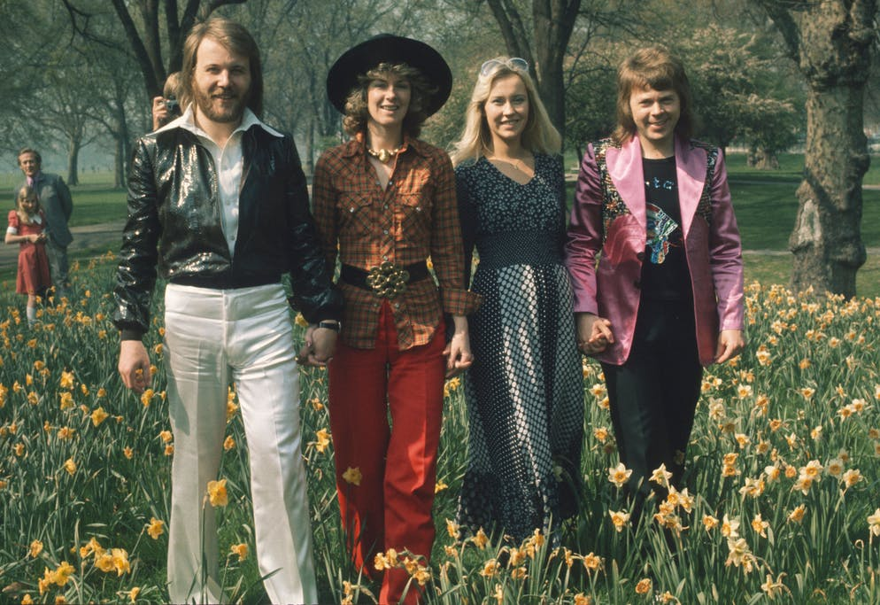 LONDON, UNITED KINGDOM - APRIL 09: Swedish pop group Abba, winners of the 1974 Eurovision Song Contest at Brighton, strolling hand in hand amongst the daffodils in Hyde Park on April 09, 1974 in London, England.  (Photo by Anwar Hussein/Getty Images)
