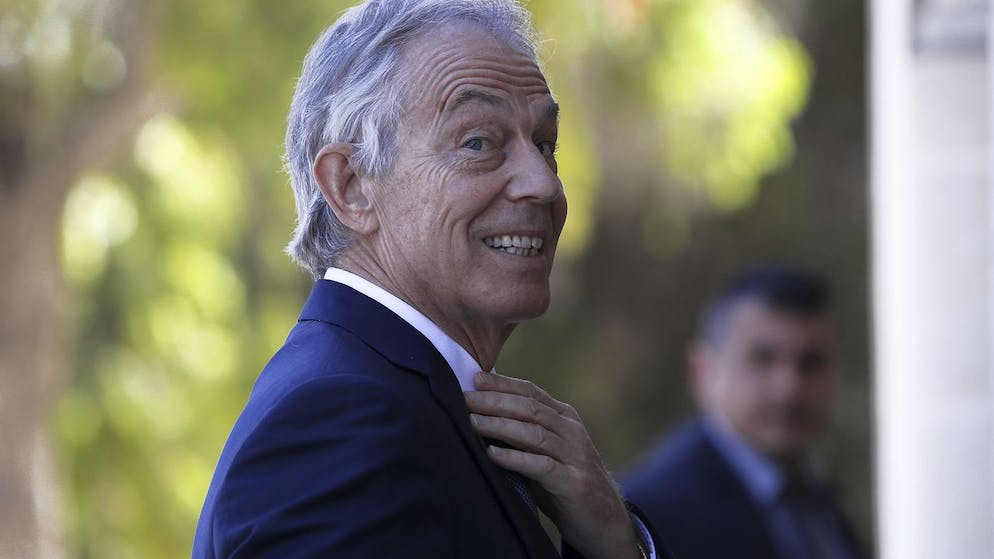 Former British Prime Minister Tony Blair arrives at the presidential palace for a meeting with Cyprus' President Nicos Anastasiades in capital Nicosia, Cyprus, Wednesday, April 4, 2018. Blair met with Cyprus President Nicos Anastasiades during a private visit to the island, heralding his new personal ties to Cyprus, saying that his daughter-in-law hails from the east Mediterranean island. Blair said he and Anastasiades discussed regional issues as well as keeping Cyprus' ties with Britain strong. (AP Photo/Petros Karadjias)
