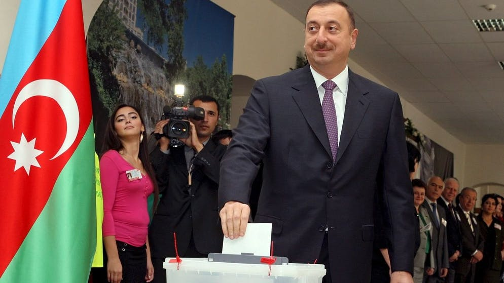 epa01520585 Azerbaijan's President Ilham Aliyev casts his ballot in a polling station in Baku, Azerbaijan, 15 October 2008. Seeped in oil wealth and in the cross hairs of a regional power struggle between the US and Russia, Azerbaijan votes on 15 October to re-elect President Ilham Aliyev, whose only real opponents will be boycotting the polls. Aliyev, 46, replaced his strongarm father Heydar Aliyev in 2003. Obeservers say there is as good as no chance the coming election will break the 35 years of dynastic rule over the Caspian state. EPA/SERGEI ILNITSKY