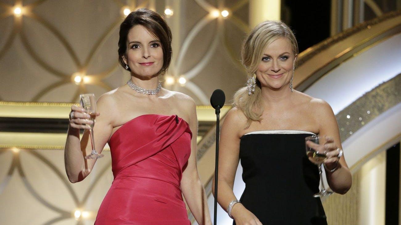 Tina Fey (l.) und Amy Poehler werden dieses Mal zwar nicht nebeneinander stehen, aber die Chemie zwischen den beiden dürfte trotzdem vorhanden sein.