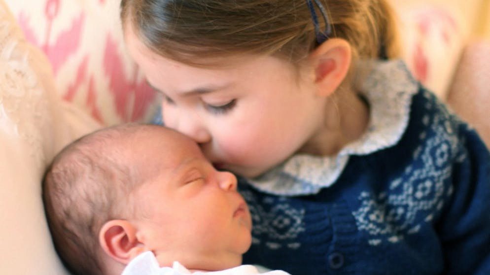 epa06714385 A handout photo made available by the Kensington Palace on 05 May 2018 and taken by Catherine, Duchess of Cambridge shows her daughter Princess Charlotte kissing her brother Prince Louis on her third birthday in London, Britain, 02 May 2018. Kensington Palace on 27 April 2018 has announced that the third child of Prince William, Duke of Cambridge and his wife Catherine, Duchess of Cambridge will be called Prince Louis Arthur Charles of Cambridge. He was born on 23 April. EPA/DUCHESS OF CAMBRIDGE HANDOUT HANDOUT EDITORIAL USE ONLY/NO SALES
