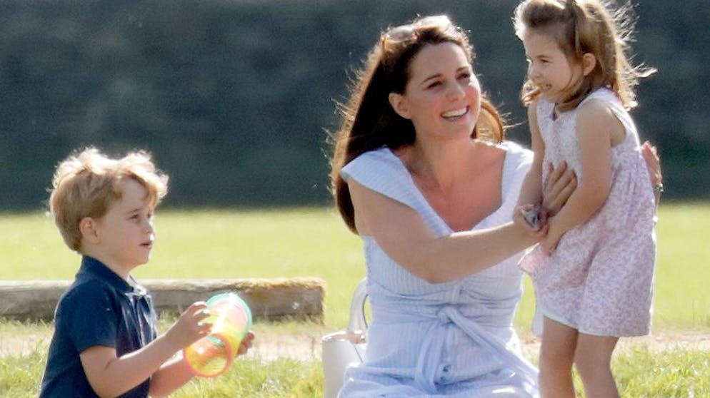 GLOUCESTER, UNITED KINGDOM - JUNE 10: (EMBARGOED FOR PUBLICATION IN UK NEWSPAPERS UNTIL 24 HOURS AFTER CREATE DATE AND TIME) Prince George of Cambridge, Catherine, Duchess of Cambridge and Princess Charlotte of Cambridge attend the Maserati Royal Charity Polo Trophy at the Beaufort Polo Club on June 10, 2018 in Gloucester, England. (Photo by Max Mumby/Indigo/Getty Images)