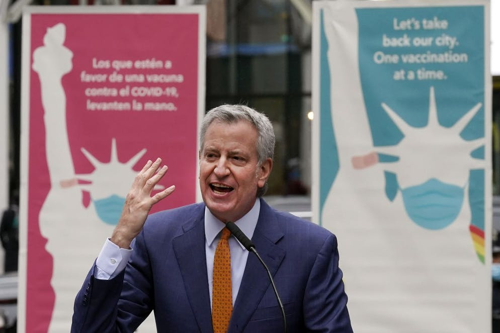 New York Mayor Bill de Blasio delivers his remarks in Times Square after he toured the grand opening of a Broadway COVID-19 vaccination site intended to jump-start the city's entertainment industry, in New York, Monday, April 12, 2021. (AP Photo/Richard Drew)