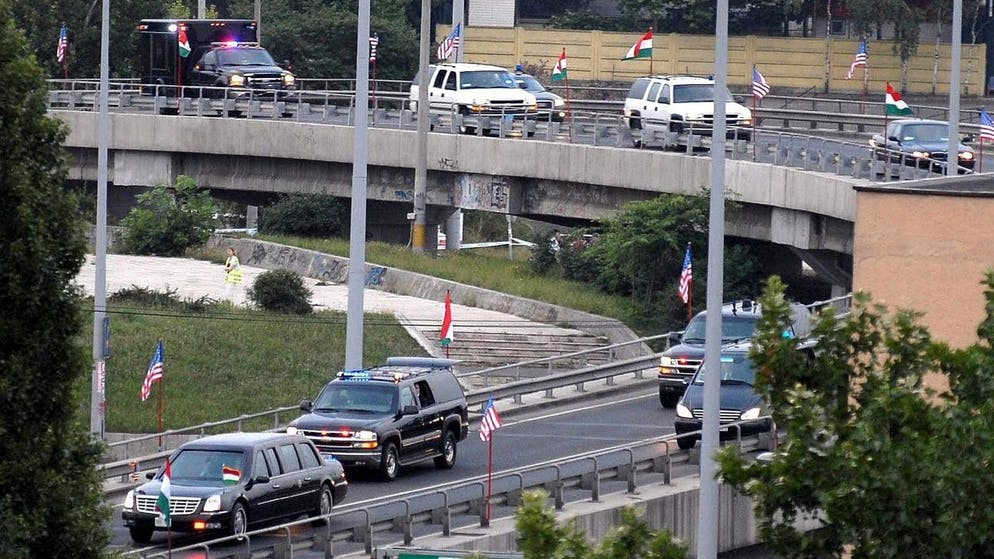 A convoy of cars, carrying U.S. President George W. Bush and First Lady Laura Bush leave from the Ferihegy airport on Wednesday, 21 June 2006, after President Bush arrived for a one day official visit in the Hungarian capital. EPA/ZOLTAN MIHADAK HUNGARY OUT