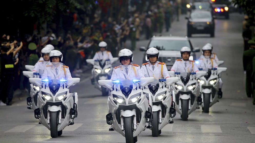 Police motorcycles lead a motorcade of U.S. President Donald Trump back to his hotel in Hanoi, Vietnam, Thursday, Feb. 28, 2019. Trump and North Korean leader Kim Jong Un cut short their second summit Thursday without reaching an agreement, a stunning collapse of talks that caused both leaders to leave their Vietnam meeting early and cancel a planned signing ceremony. (AP Photo/Minh Hoang)