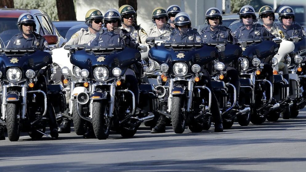 epa06244783 Motorcycle police line up after escorting US President Donald J. Trump to University Medical Center to meet with hospital personnel and victims of the mass shooting at the Route 91 Harvest Festival in Las Vegas, Nevada, USA, 04 October, 2017. Trump will also meet with first responders and police personnel later in his visit. EPA/PAUL BUCK