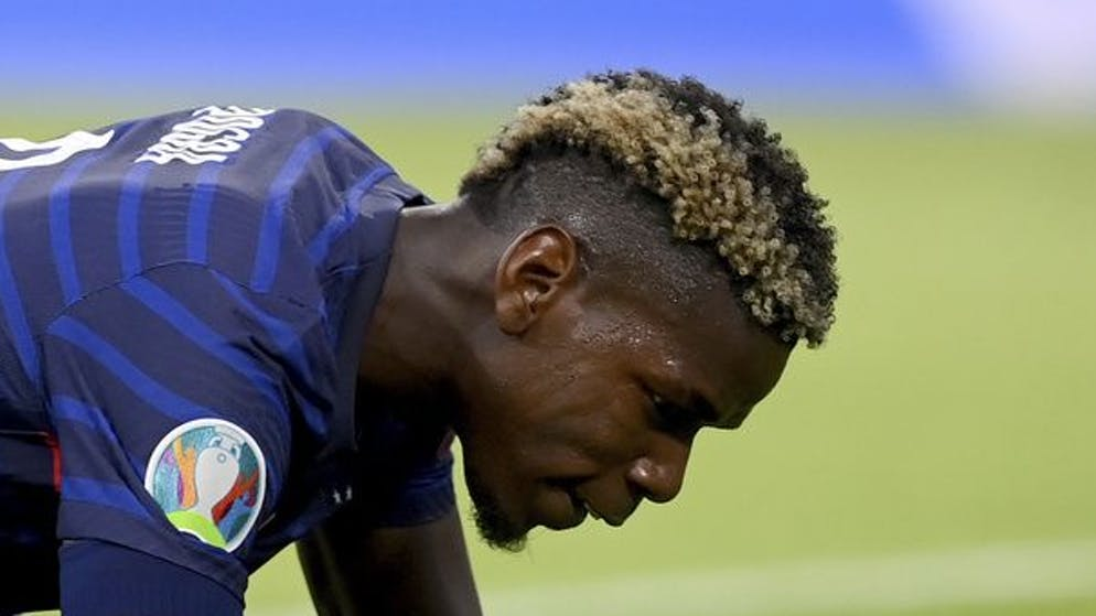 France's Paul Pogba reacts after missing an opportunity during the Euro 2020 soccer championship group F match between France and Germany at the Allianz Arena stadium in Munich, Tuesday, June 15, 2021. (Matthias Hangst/Pool via AP)
