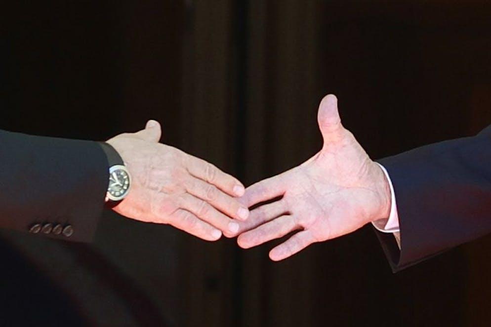 U.S. President Joe Biden, right, and Russia's President Vladimir Putin, left, shake hands during the U.S.-Russia summit at Villa La Grange in Geneva, Switzerland, Wednesday, June 16, 2021. (KEYSTONE/REUTERS POOL/Denis Balibouse)