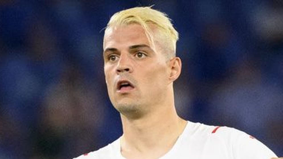 Switzerland's midfielder Granit Xhaka reacts during the Euro 2020 soccer tournament group A match between Italy and Switzerland at the Olympic stadium, in Rome, Italy, Wednesday, June 16, 2021. (KEYSTONE/Jean-Christophe Bott)