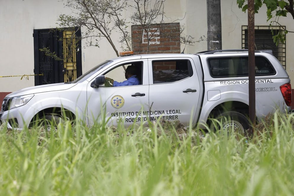 epa09217673 A view of a vehicle of the Institute of Legal Medicine at an area where human remains were found, at the house of former police officer Hugo Ernesto Osorio, who is being investigated for homicide, in Chalchuapa, northwest of San Salvador, El Salvador, 20 May 2021 (issued 21 May 2021). EPA/RODRIGO SURA