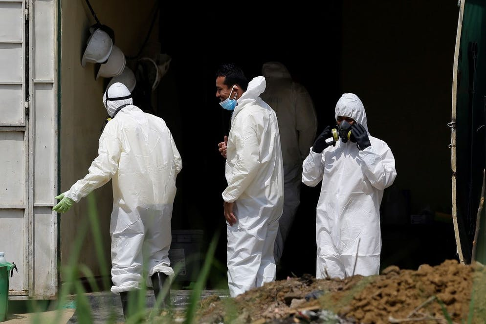 epa09217672 Forensic teams, members of the Attorney General's Office, and police officers work during a search for human remains at the house of former police officer Hugo Ernesto Osorio, who is being investigated for homicide, in Chalchuapa, northwest of San Salvador, El Salvador, 20 May 2021 (issued 21 May 2021). EPA/RODRIGO SURA
