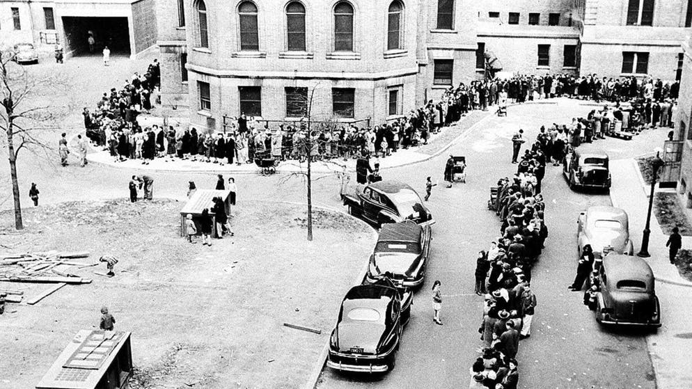 People stand in a line waiting to be inoculated against smallpox at the Morrisania Hospital in the Bronx borough of New York, in this April 14, 1947, file photo. In 2002, scientists are watching various computer simulations to determine what might happen if terrorists unleashed smallpox on the United States. (AP Photo/File)