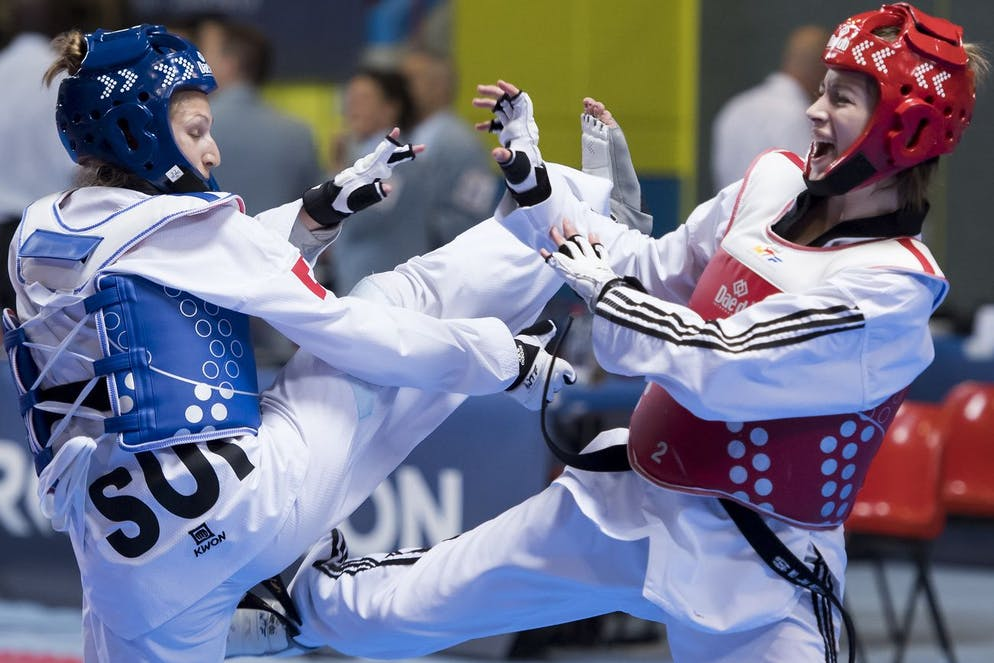 Manuela Bezzola of Switzerland, left, fights against Zeliha Agris of Turkey, right, during the quarter final of the Seniors Female A - 53kg at the European Taekwondo Championships in Montreux, Switzerland, Friday, May 20, 2016. (KEYSTONE/Jean-Christophe Bott)